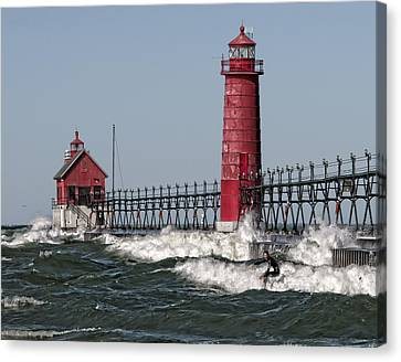 Surfing At Grand Haven Canvas Print by Wade Aiken