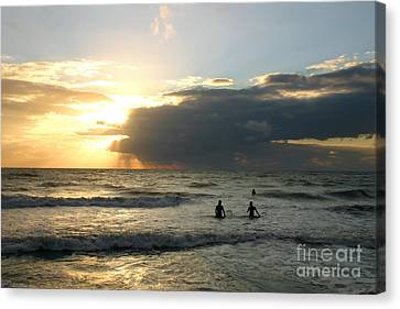 Surfing Into Sunset Canvas Print