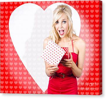 Surprised Attractive Girl With Heart Gift Box Canvas Print