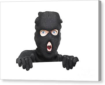Hiding Canvas Print - Surprised Robber Holding Blank Security Sign by Jorgo Photography - Wall Art Gallery