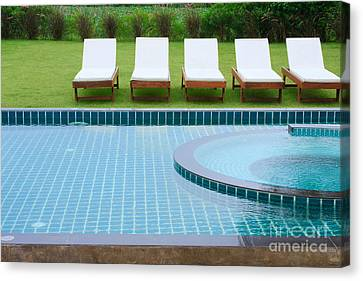 Swimming Pool And Chairs Canvas Print by Atiketta Sangasaeng