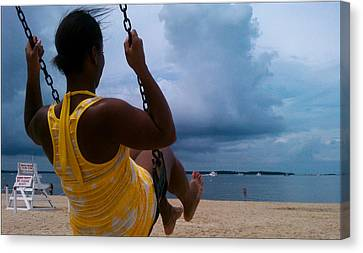 Swinging On A Stormy Sandy Beach Canvas Print by Paul SEQUENCE Ferguson             sequence dot net