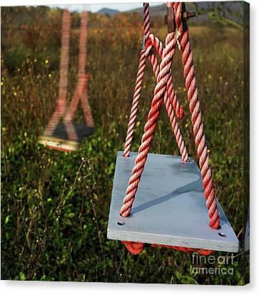 Swings Canvas Print by Bernard Jaubert