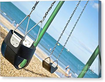 Canvas Print featuring the photograph Swings On The Ocean Beach by Yurix Sardinelly