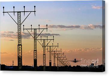 Symmetrical Floodlights And Airplane Taking Off Canvas Print