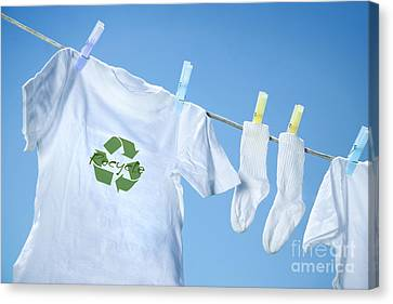 T-shirt With Recycle Logo Drying On Clothesline On A  Summer Day Canvas Print by Sandra Cunningham