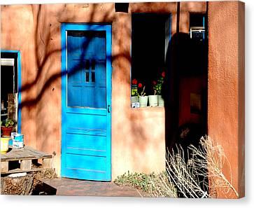 Taos Blue Door Canvas Print by Kathleen Stephens