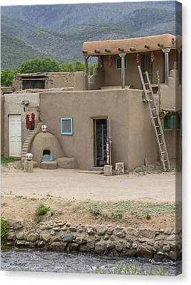 Taos Pueblo Adobe House With Pots Canvas Print by Allen Sheffield
