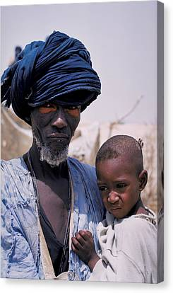 Taureg Father And Son In Senegal Canvas Print by Carl Purcell