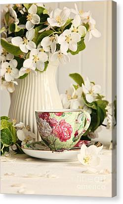 Tea Cup With Fresh Flower Blossoms Canvas Print by Sandra Cunningham