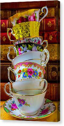 Tea Cups Stacked Against Old Books Canvas Print