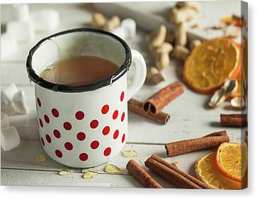 Tea In A Dotted Mug On White Background Canvas Print by Denes Demeter