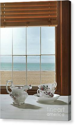 Teacups In The Window Canvas Print by Amanda Elwell