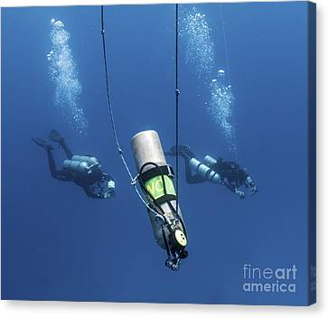 Technical Divers Ascend Near A Nitrox Canvas Print by Karen Doody