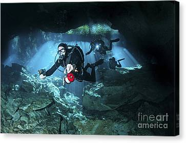 Technical Divers Enter The Cavern Canvas Print by Karen Doody