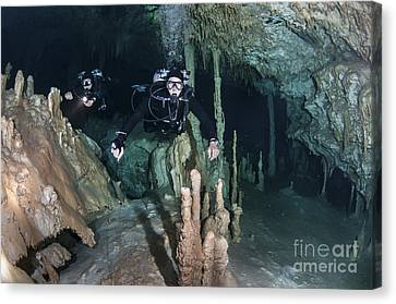 Technical Divers In Dreamgate Cave Canvas Print by Karen Doody