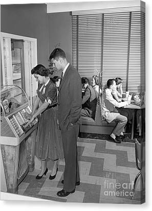 Teen Couple Playing Jukebox, C. 1950s Canvas Print
