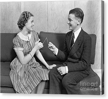Teen Couple Pulling Wishbone, C.1930s Canvas Print by H. Armstrong Roberts/ClassicStock