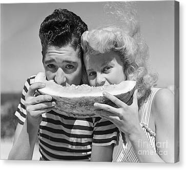 Sharing Canvas Print - Teen Couple Sharing Watermelon, C.1950s by H. Armstrong Roberts/ClassicStock