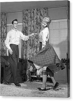 Teenage Couple Dancing Jitterbug Canvas Print by Debrocke/ClassicStock