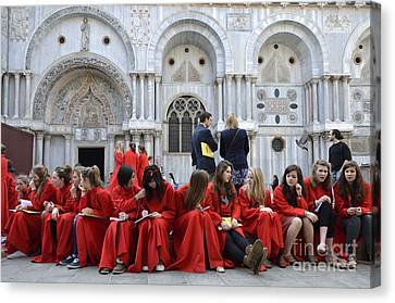 Teenager Girls From A Uk Choral Group Waiting Outside St Mark Basilica In Venice Canvas Print by Sami Sarkis