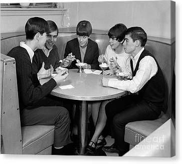 Teenagers In A Cafe, C.1960s Canvas Print by H. Armstrong Roberts/ClassicStock