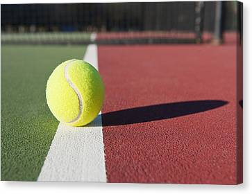 Tennis Ball Sitting On Court Canvas Print by Thom Gourley/Flatbread Images, LLC