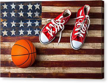 Tennis Shoe Canvas Print - Tennis Shoes And Basketball On Flag by Garry Gay