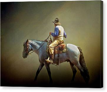 Canvas Print featuring the photograph Texas Cowboy And His Horse by David and Carol Kelly