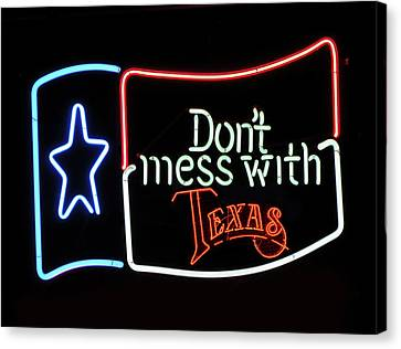 Canvas Print featuring the photograph Texas Flag Saloon Neon by Daniel Hagerman
