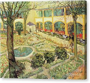 The Asylum Garden At Arles Canvas Print by Vincent van Gogh