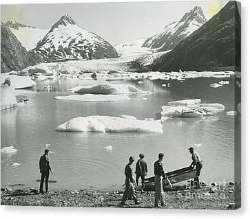 the beach of a small lake of melted glacial water by Portage Glacier Canvas Print by Celestial Images