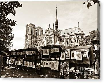 The Bouquinistes And Notre-dame Cathedral Canvas Print by Perry Van Munster