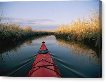 Solar Phenomena Canvas Print - The Bow Of A Kayak Points The Way by Skip Brown