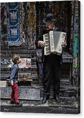The Busker And The Boy Canvas Print by Vince Russell