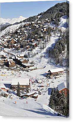 The Busy Chaudanne In Meribel The Heart Of Meribel In The Three Valleys Resort France Canvas Print by Andy Smy
