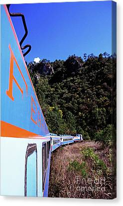 The Chihuahua-pacific Railway Travelling Through The Copper Canyon Canvas Print by Sami Sarkis