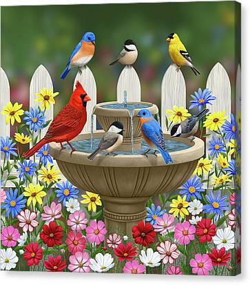 Cosmos Canvas Print - The Colors Of Spring - Bird Fountain In Flower Garden by Crista Forest