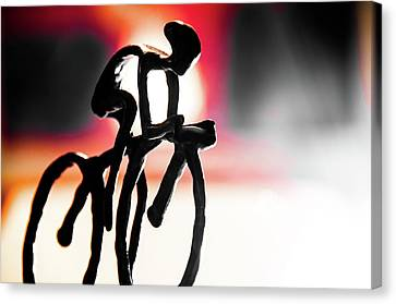 The Cycling Profile  Canvas Print by David Sutton