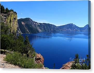 The Deep Blue Crater Lake Canvas Print by Christiane Schulze Art And Photography
