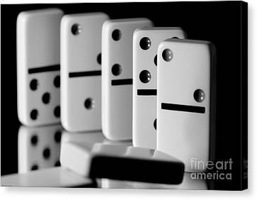 The Domino Effect Canvas Print by Charles Dobbs