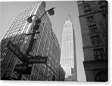 The Empire State Building In New York City Canvas Print by Ilker Goksen