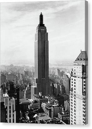 The Empire State Building Under Construction Canvas Print by Jon Neidert