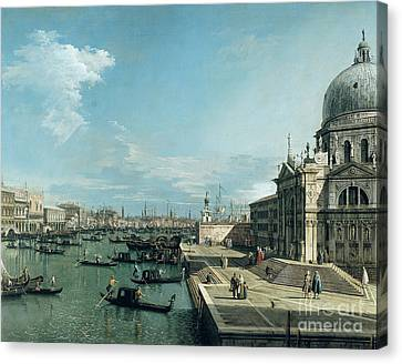 The Entrance To The Grand Canal And The Church Of Santa Maria Della Salute Canvas Print by Canaletto
