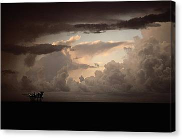The Faint Lights Of A Gas Platform Canvas Print by Wolcott Henry