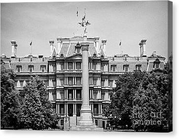 the first division monument in front of the old executive office building Washington DC USA Canvas Print by Joe Fox
