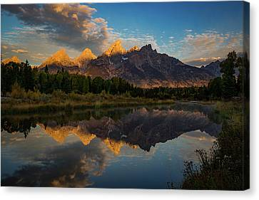 Teton Canvas Print - The First Light by Edgars Erglis