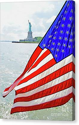 The Flag Flies For The Statue Of Liberty Canvas Print