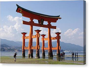 Floating Torii Canvas Print -  The Floating Torii Gate Of The Itsukushima Shrine In Japan During Low Tide by Paul Fearn