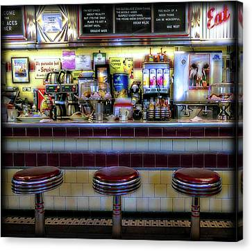 Old Diner Bar Stools Canvas Print - The Four Aces Diner by Sherman Perry